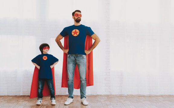 Father And Son In Superhero Suits. Family Concept.