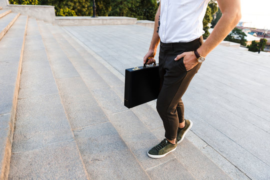 Cropped image of young business man with briefcase