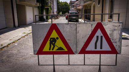 road signs indicating road repair. repair of urban road infrastructure.