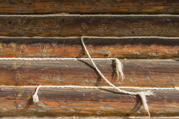 Weathered old wooden surface, texture with ropes, texture. Rustic horizontal planks with cracks, scratches for grunge design, patterns, background, copy space