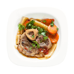 italian dish Ossobuco in white plate isolated