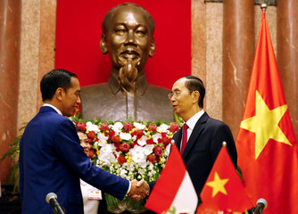 Indonesian President Joko Widodo, left, and Vietnamese counterpart Tran Dai Quang shake hands following a signing ceremony at the Presidential Palace in Hanoi