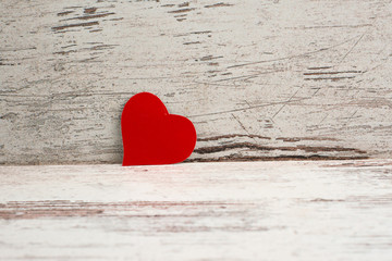 red Love heart on white-painted wooden texture background