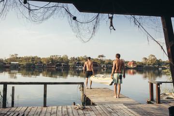 Two Men Carrying a Kayak