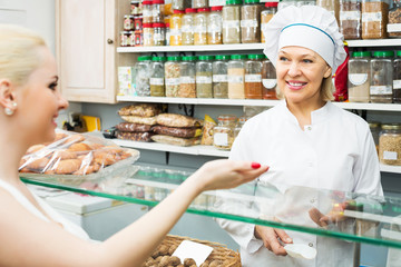 Woman offering female client nuts