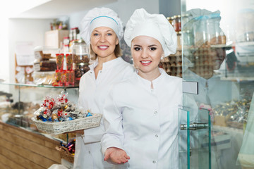 Female staff greeting clients in local confectionery
