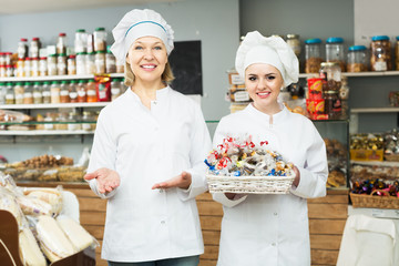 Two female sellers in confectionery