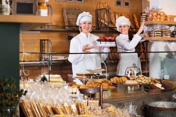 Hospitable women at bakery display