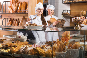 Friendly women at bakery display