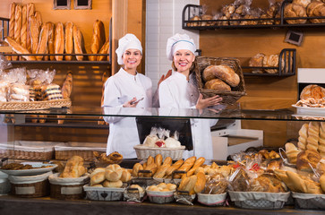 Smiling women at bakery.