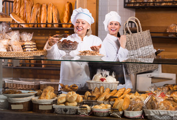 staff offering bread and pastry