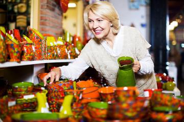 Woman posing with ceramic tableware