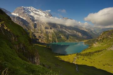 Mountains above the lake of Oeschinensee nearby resort of Kandersteg, Switzerland