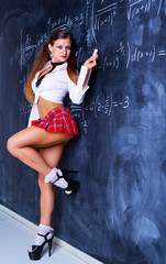 attractive striptease dancer dressed as a schoolgirl