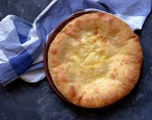Khachapuri, thin pies with cheese. Georgian cuisine. Top view