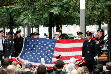 A U.S. flag that few over the World Trade Center is presented during ceremonies marking the 17th anniversary of the September 11, 2001 attacks on the World Trade Center, at the National 9/11 Memorial and Museum in New York