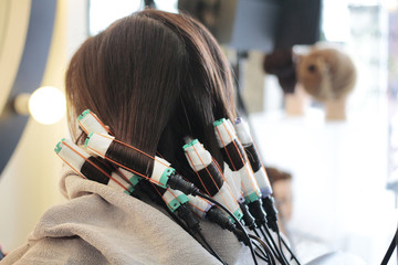 seventh step of roll the hair in perming