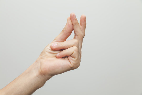 Male hand showing ''snap'' gesture, snapping or clicking with two fingers