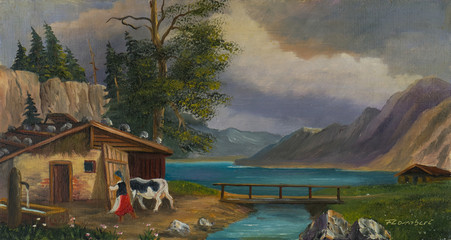 Frau bringt an einem See die Kuh in den Stall