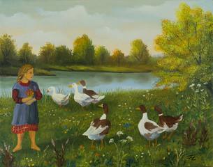 Mädchen beobachtet am See die Enten und Gänse