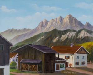Mehrere Häuser und eine Scheune in den Bergen