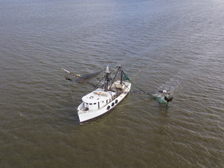 Aerial close up view of shrimp boat at sea