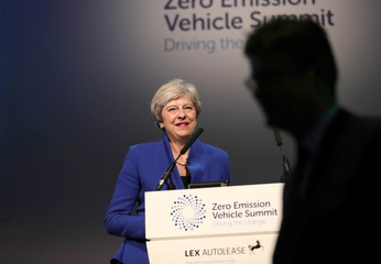 Britain's Prime Minister Theresa May makes a speech at the Zero Emission Vehicle Summit at the ICC in Birmingham