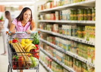 Close-up portrait of happy young woman in grocery shop