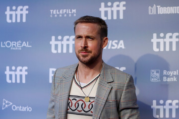 """Actor Ryan Gosling arrives for a news conference to discuss the movie """"First Man"""" at the Toronto International Film Festival in Toronto"""