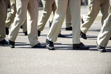 Military marching in a street. Legs and shoes in line