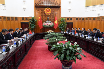Chinese Vice Premier Hu Chunhua and Vietnamese Prime Minister Nguyen Xuan Phuc are seen during their meeting at the government office in Hanoi