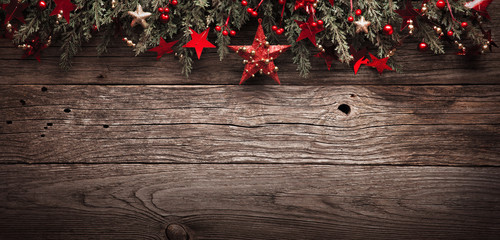 Christmas Fir Tree With Decorations and Red Star On Wooden Background