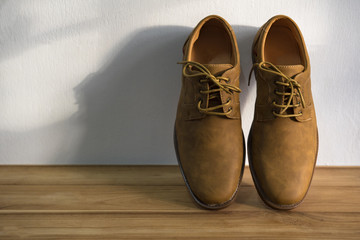 Brown cut leather shoes on wooden floor,Vintage style