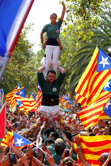 People form a human tower during a rally on Catalonia's national day 'La Diada' in Barcelona