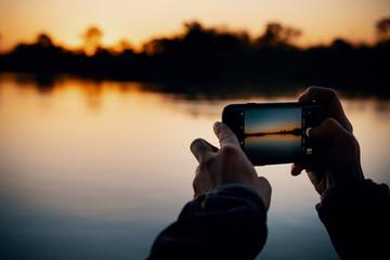 Sonnenuntergang fotografieren am Okavango Fluss, Namibia