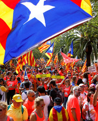 People take part in a rally during Catalonia's national day 'La Diada' in Barcelona