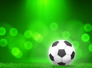 soccer ball on grass with  green bokeh  background