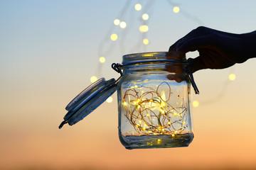 Fototapete - Lichterkette im Glas