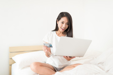 Woman use of notebook computer with credit card