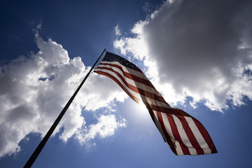 American Flag United States Stars and Stripes Backlit Cloudy Sky