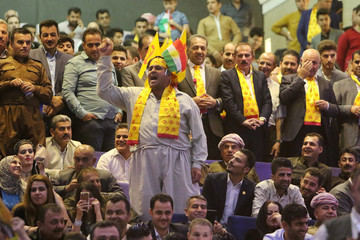 Supporters of Former Iraqi Kurdistan region's President Masoud Barzani, shout slogans ahead of regional elections in Erbil