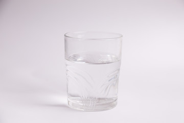 glass of water in color background