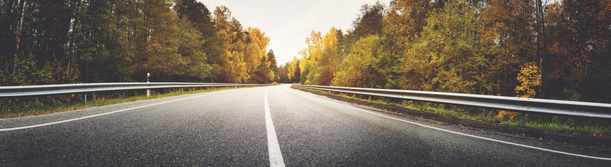 Printed roller blinds Autumn asphalt road with beautiful trees on the sides in autumn