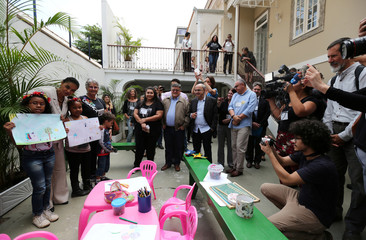 Presidential candidate Marina Silva of the Brazilian Sustainability Network Party poses for pictures with children at the NGO Saude Crianca in Rio de Janeiro