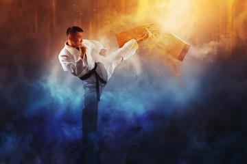 Wall Murals Martial arts Karate man breaking with leg wooden board