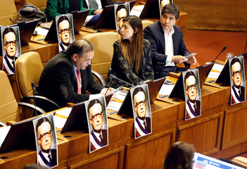 Images of Chile's late President Salvador Allende are seen inside of the session room at Congress marking the 45th anniversary of the 1973 Chile military coup, in Valparaiso