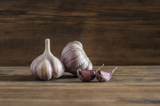 Purple garlic on vintage wooden table