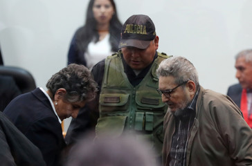 Shining Path founder Abimael Guzman and his wife and second leader Elena Iparraguirre attend a trial during sentence of a 1992 Shining Path car bomb case in Miraflores, at a high security naval prison in Callao