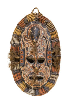Mask ritual from a tree, decorated with paints on a white background. Isolated object