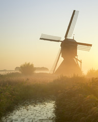 A beautiful misty morning at one of the windmills at Uppel. This Windmill is very traditional and is located in Netherlands.